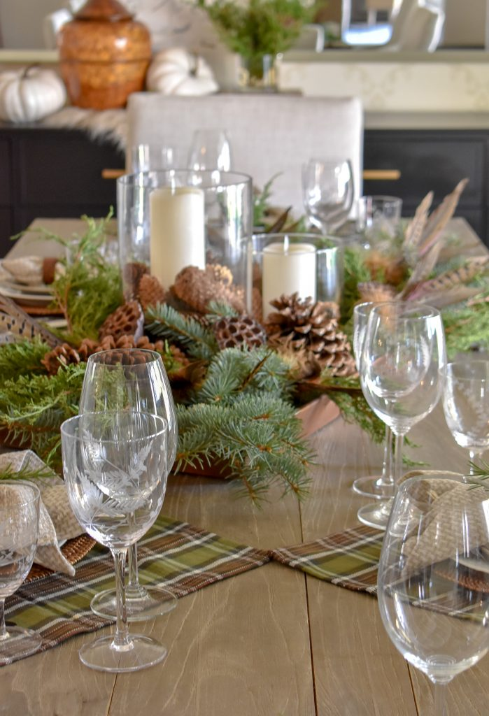A Simple, Casual Evergreen Thanksgiving Table Setting with green and brown tones