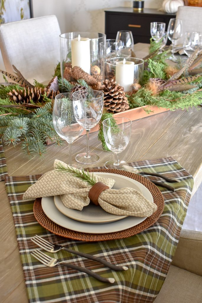 A Casual Evergreen Thanksgiving Table Setting with plaid and rosemary accents