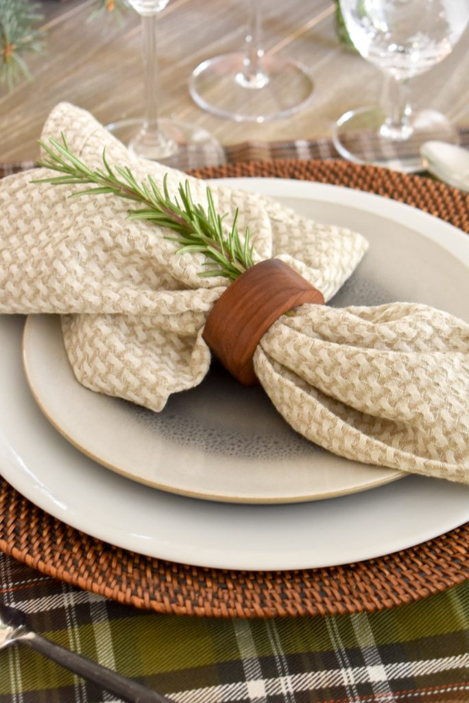 Napkin and ring with Rosemary on a Casual Evergreen Thanksgiving Table Setting