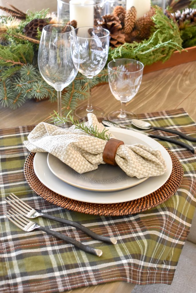 The place setting on a Casual Evergreen Thanksgiving Table Setting with plaid