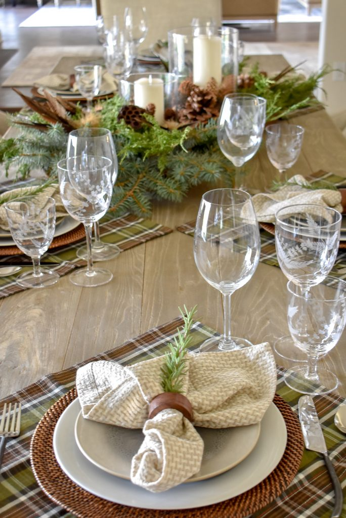 A Casual Evergreen Thanksgiving Table Setting with plaid and rosemary