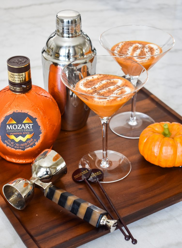 A Creamy Chocolate Pumpkin Spice Martini on a wood tray