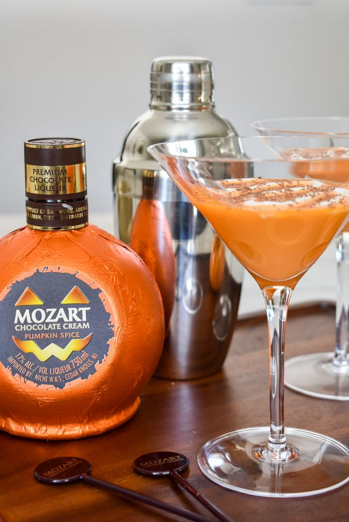 Creamy Chocolate Pumpkin Spice Martini on a wood tray