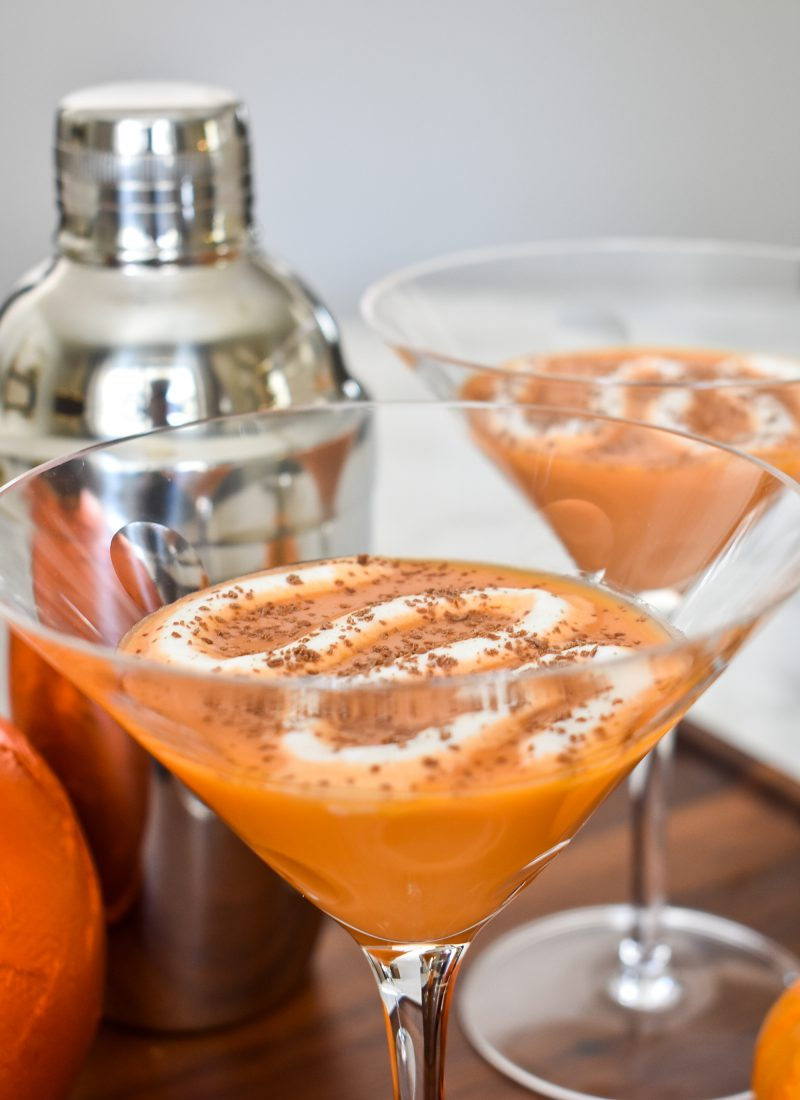 A Creamy Chocolate Pumpkin Spice Martini on a wooden tray