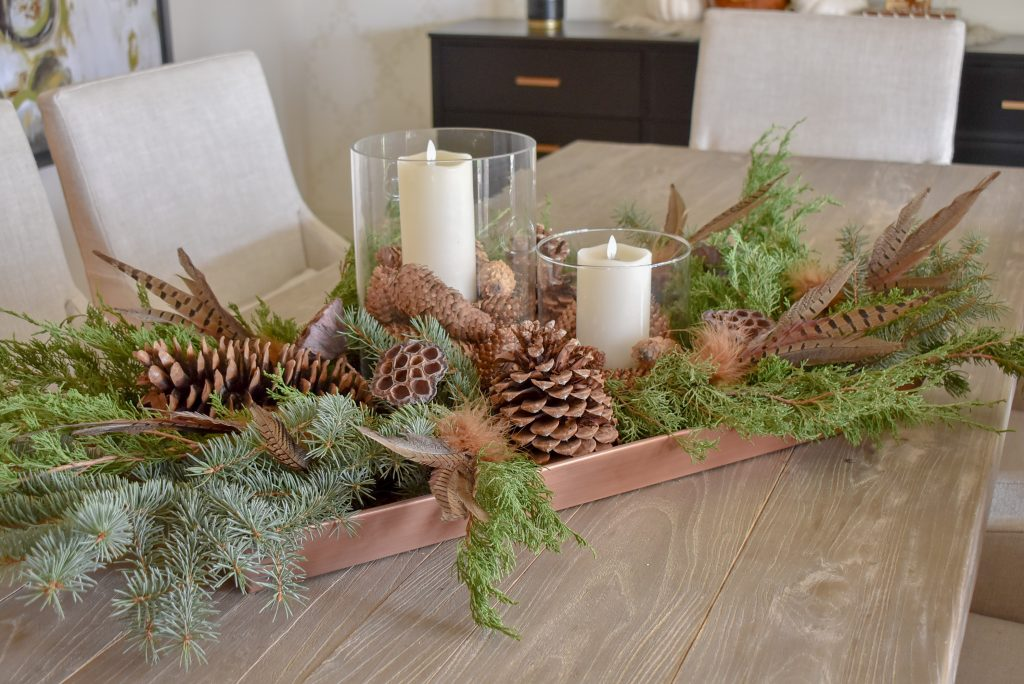 A Thanksgiving Centerpieces with natural evergreens and pine cones