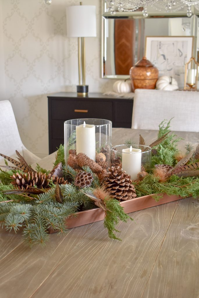 Natural greenery and pine cones on a Fall Centerpiece on a Tray