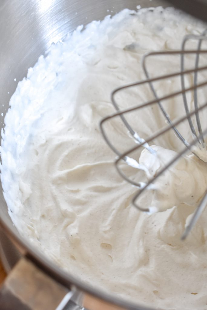 Fresh Homemade Pumpkin Spice Whipped Cream in a mixing bowl