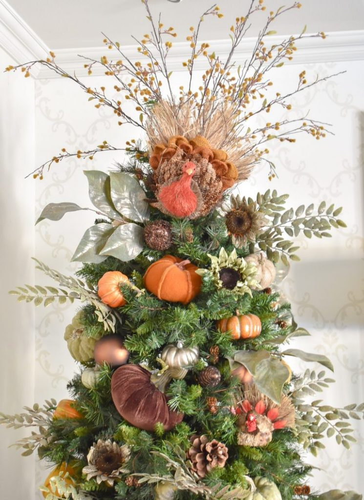 Fall-themed Topper on a Christmas Tree decorated for Thanksgiving with a natural fiber turkey