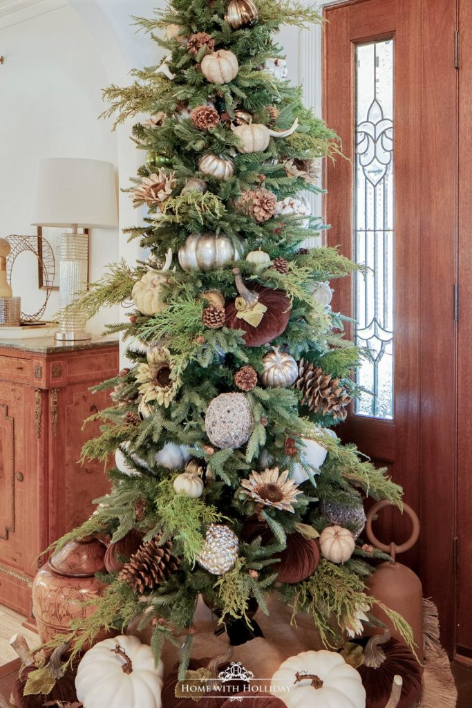 A Christmas Tree decorated for Thanksgiving or Fall with pumpkins and other fall decor