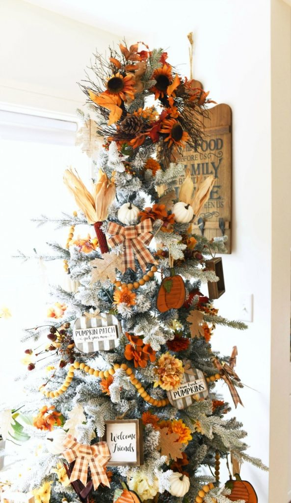 Fall decor on a Christmas Tree decorated for Thanksgiving