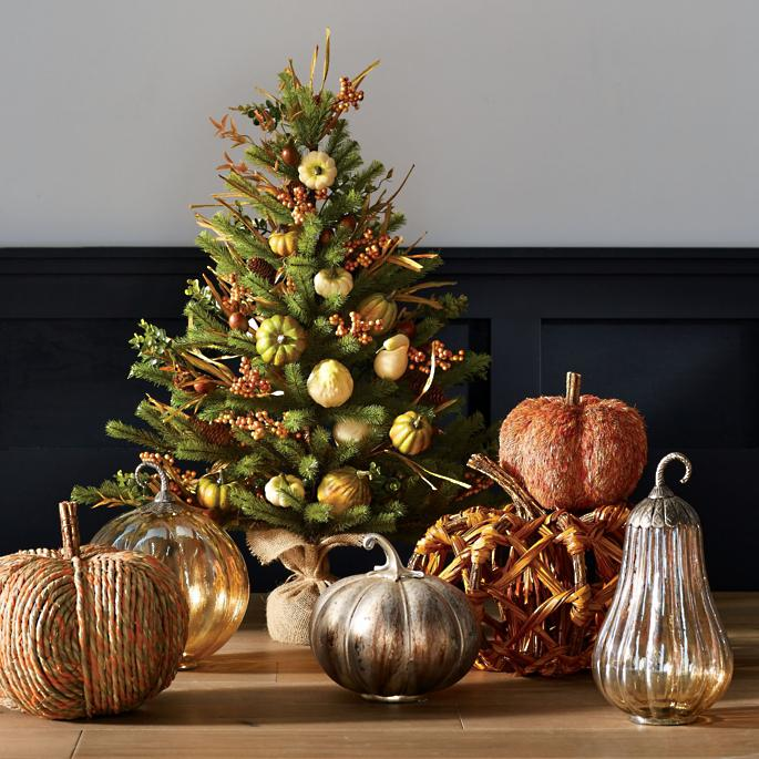 Fall decor sitting below a Fall-themed Christmas Tree