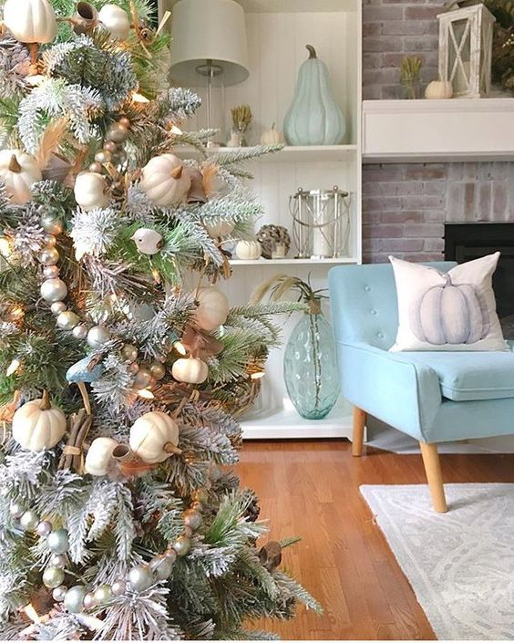 A Christmas Tree decorated for Thanksgiving or Fall with blue and ivory tones