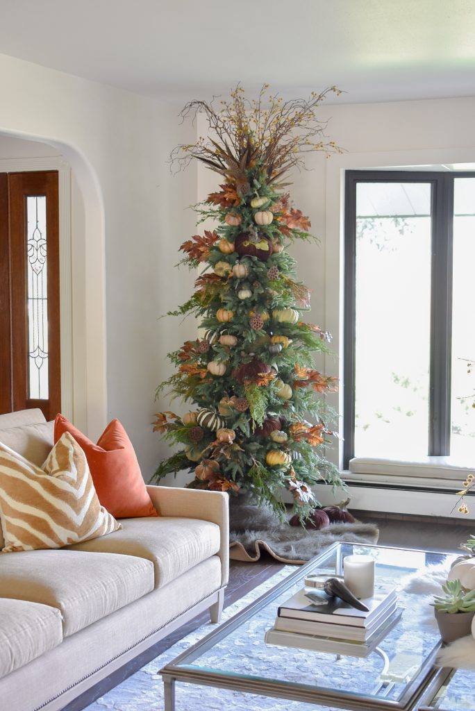 A Christmas Tree decorated for Thanksgiving or Fall in a living room