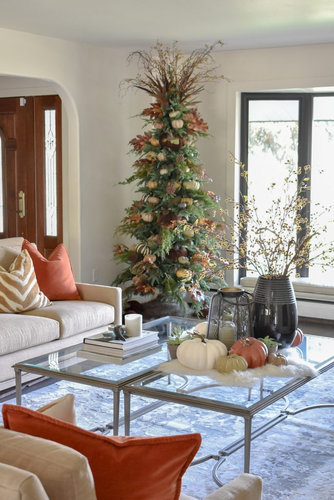 A Christmas Tree decorated for Thanksgiving in a living room