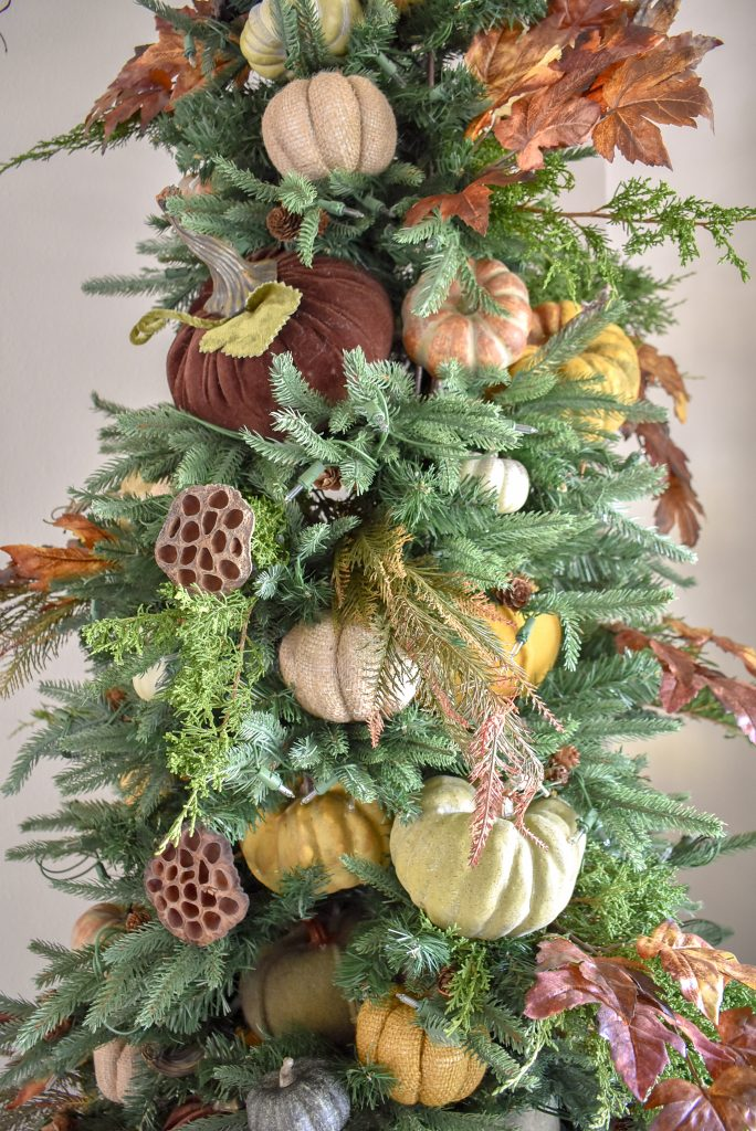 A Christmas Tree decorated for Thanksgiving or Fall with pumpkins
