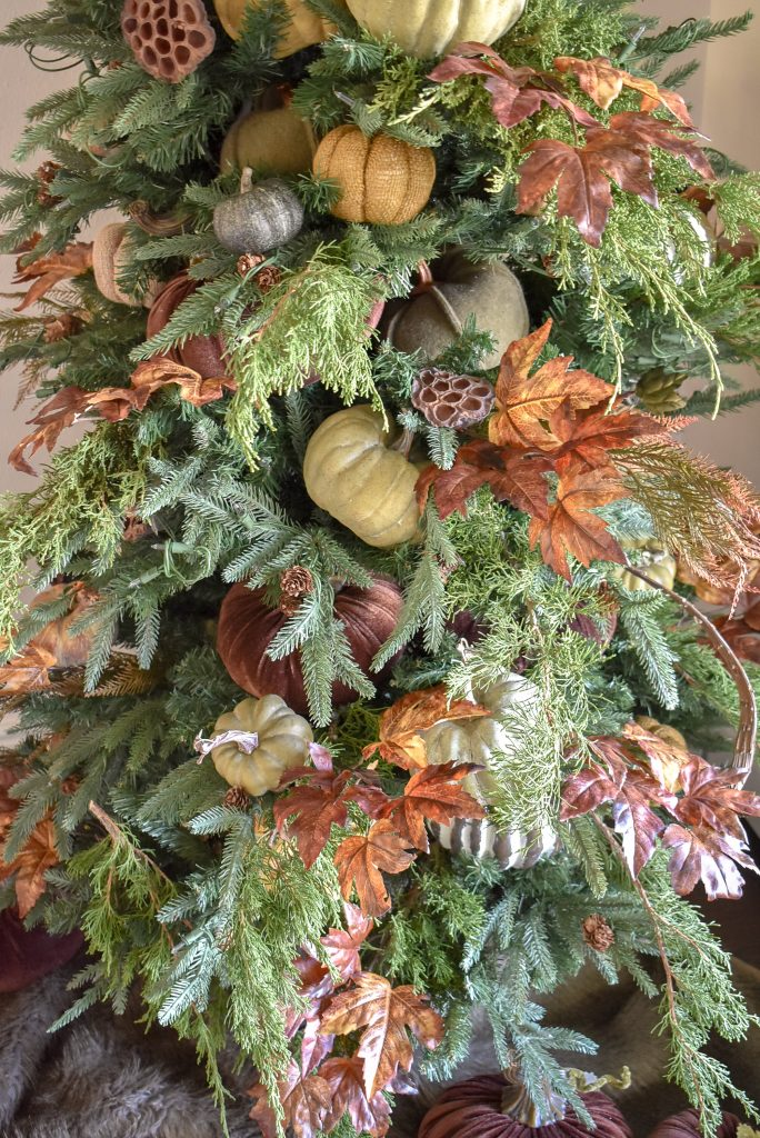 Close-up of a Christmas Tree decorated for Fall or Thanksgiving with pumpkins