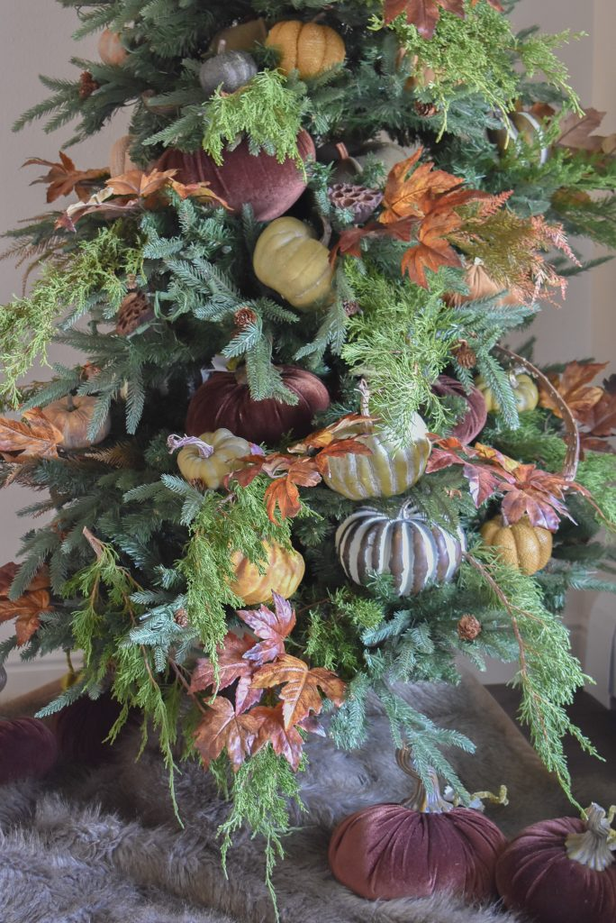 A close-up of a  Christmas Tree decorated for Thanksgiving and Fall