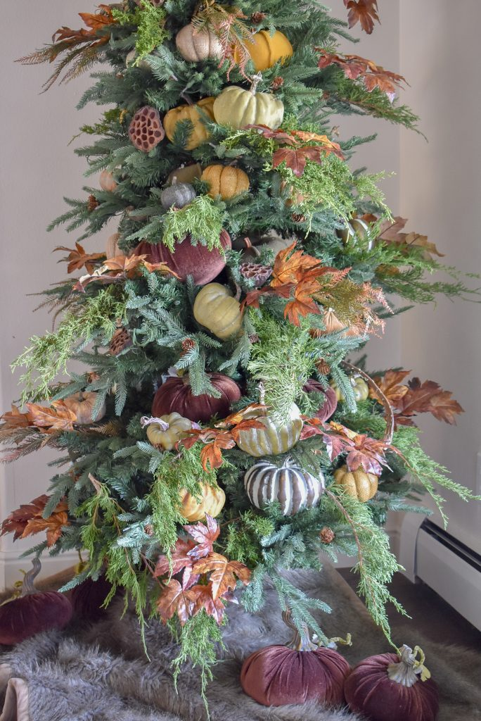 A Fall Christmas Tree decorated for Thanksgiving with pumpkins