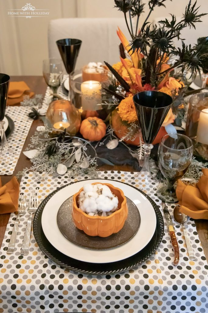 Black, white, and orange Moody Fall Tablescape for Halloween