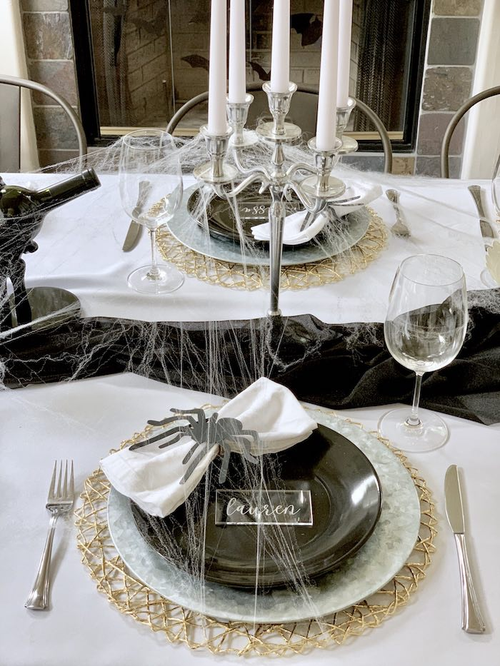 Black, white, and gold simple moody fall tablescape for Halloween