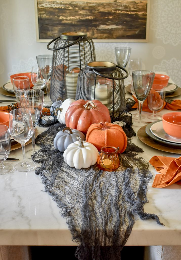 Orange, Black and White Centerpiece on a Moody Fall Tablescape