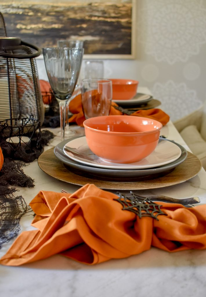 Orange, Black and White Place Settings on a Moody Fall Tablescape