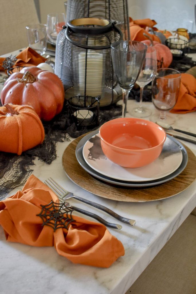 Place Settings on an Orange, Black and White Moody Fall Tablescape