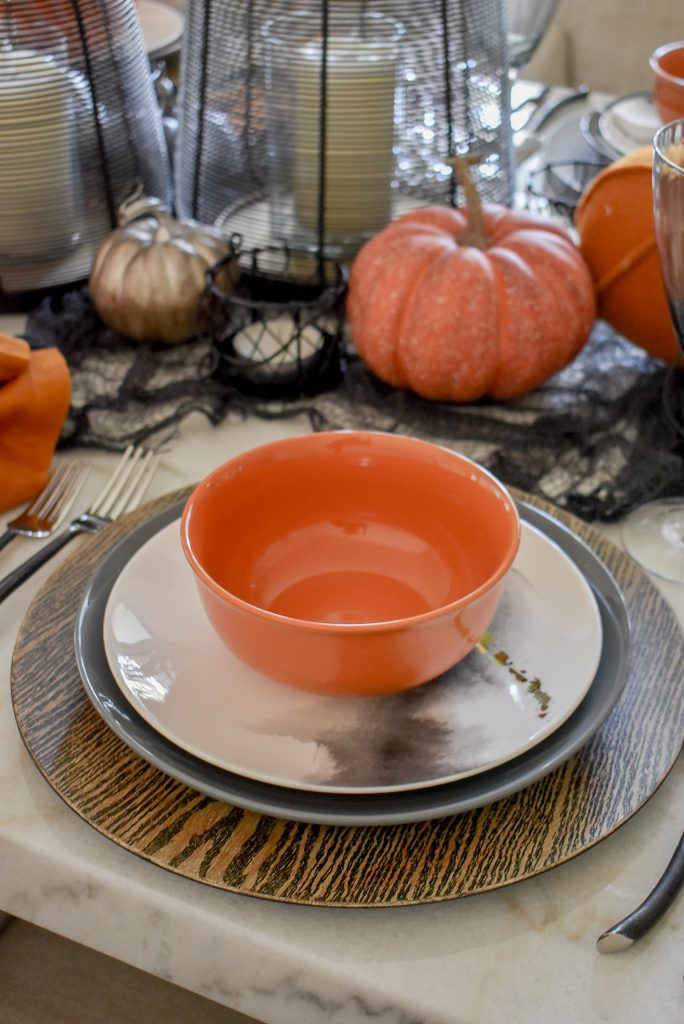 Orange, Black and White Place Setting on a Moody Fall Tablescape