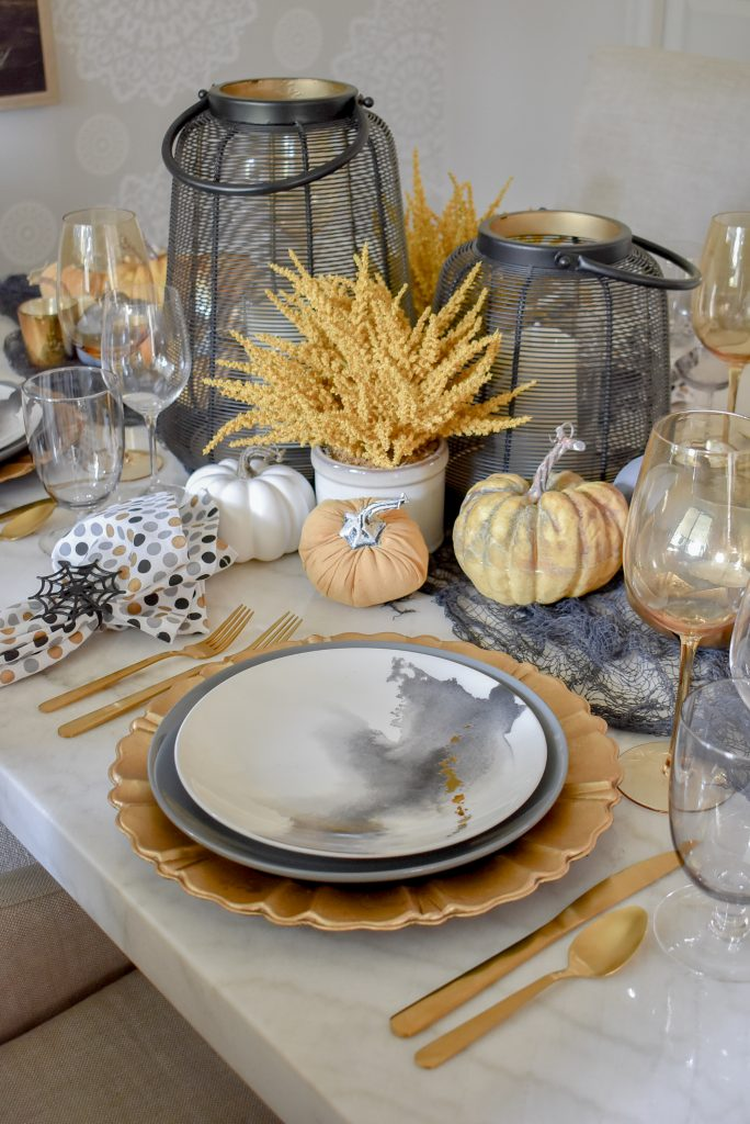Black, Harvest Gold, and White Place Settings on a Moody Fall Tablescape on a marble table