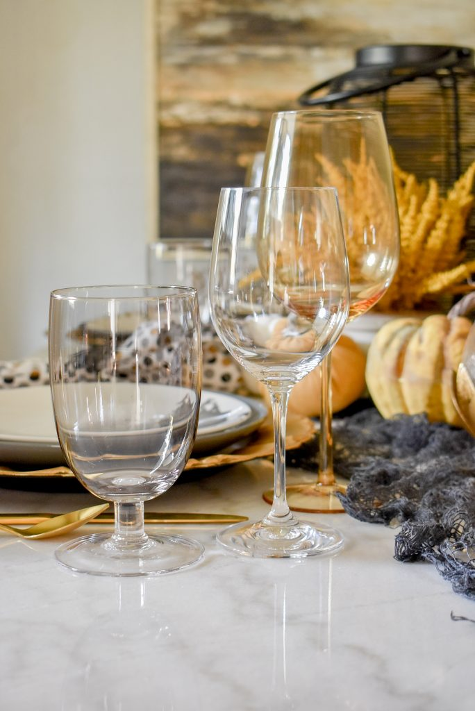 Glassware on a Black, Harvest Gold and White Moody Fall Tablescape