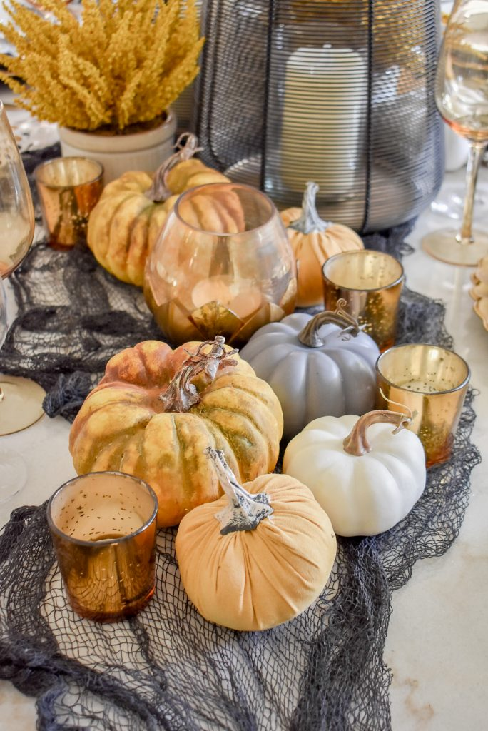 Black, Harvest Gold, and White Centerpiece on a Moody Fall Tablescape