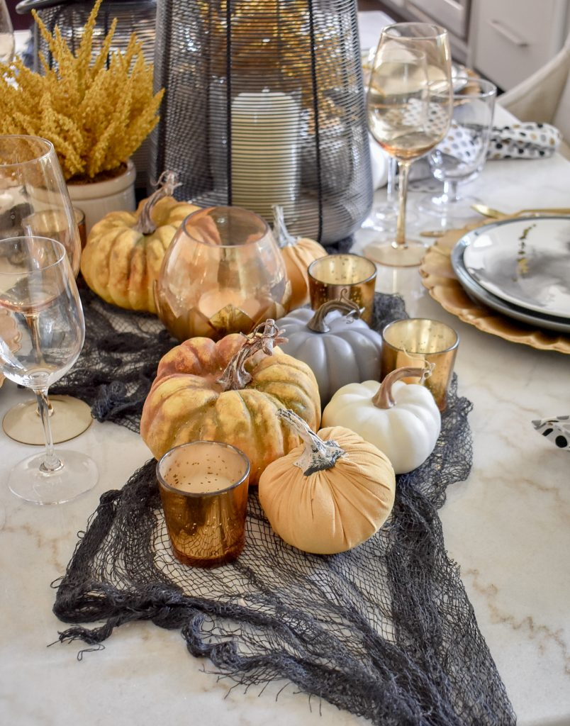Black, Harvest Gold, and White Place Centerpiece on a Moody Fall Tablescape