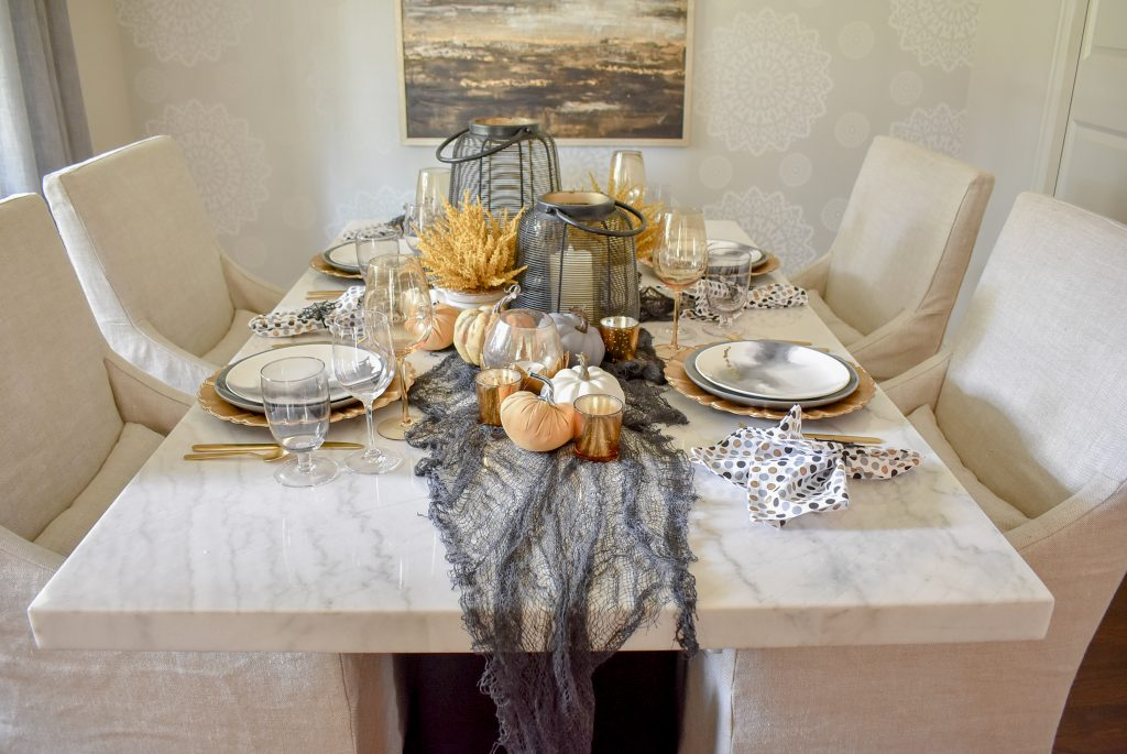 Black, Harvest Gold, and White Moody Fall Tablescape on a marble table