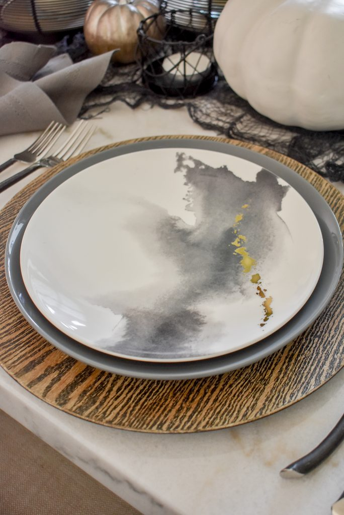Accent plates on a Grey, Black and White Moody Fall Tablescape