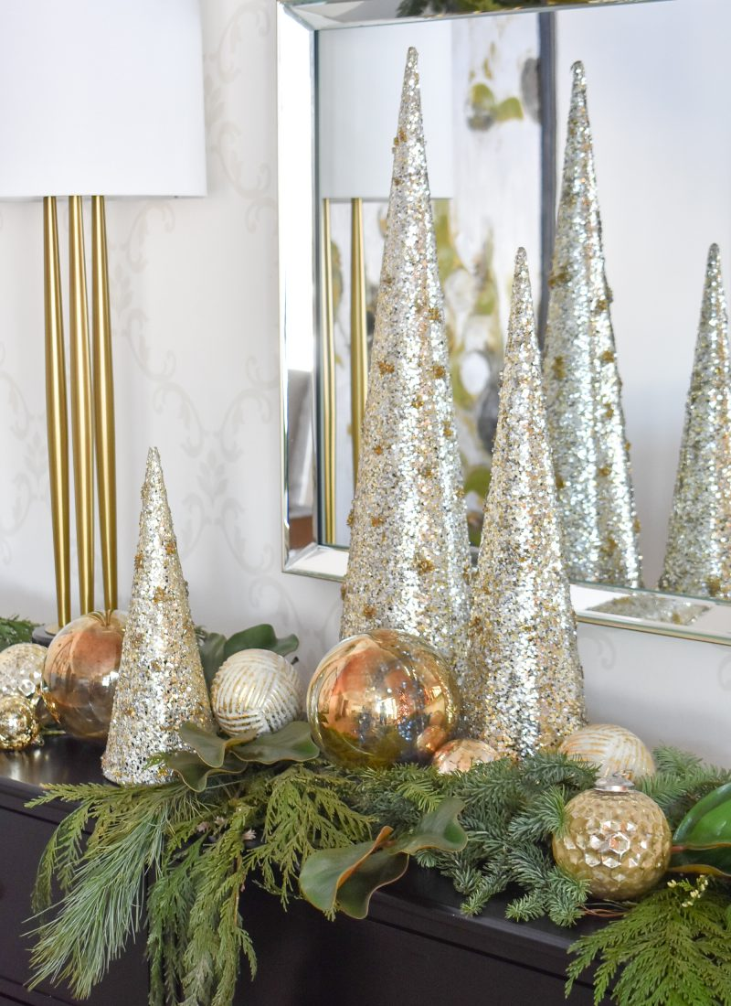 A Christmas Cone Tree Centerpiece with Evergreens and Gold Ornaments