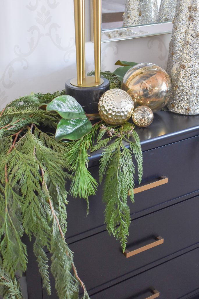 A Christmas Cone Tree Centerpiece with Evergreens and Gold