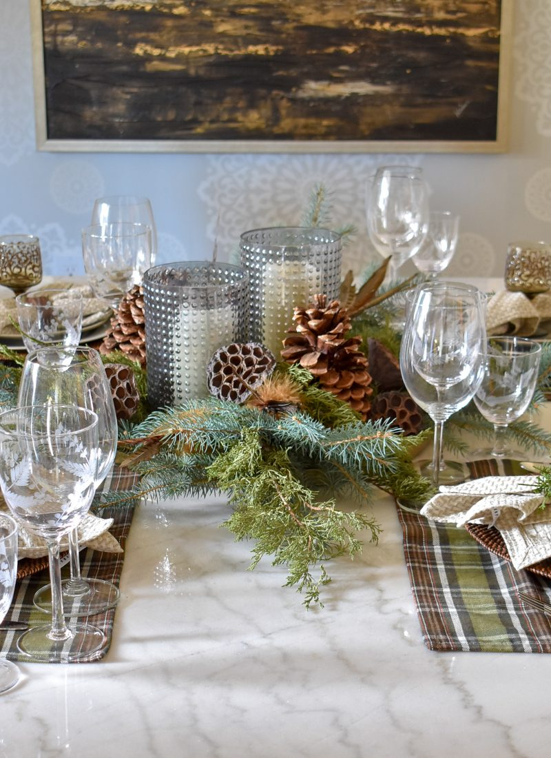 A Green and Brown Natural Tablescape with evergreens and pine cones