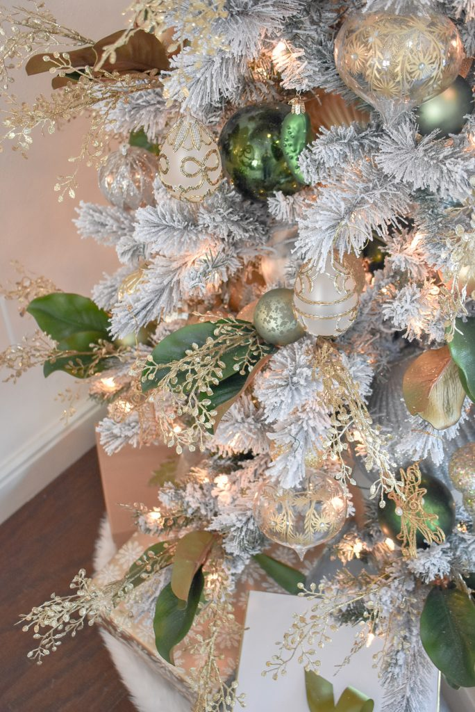 Flocked Christmas Tree in a Green and Gold Fresh Evergreen Christmas Home Tour