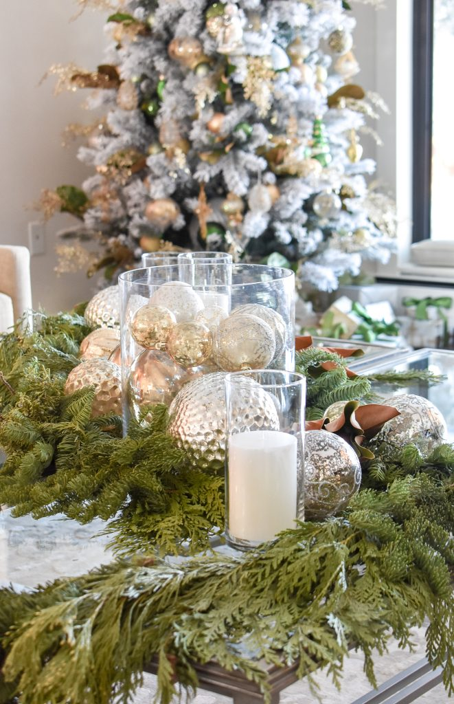 Decor around a Green and Gold Flocked Christmas Tree