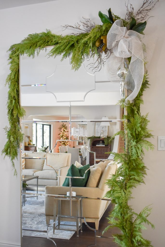 Mirror decorated to coordinate with a Green and Gold Flocked Christmas Tree