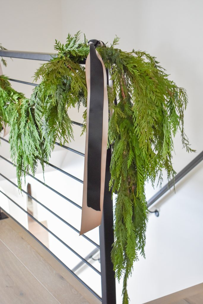 Stair railing decorated with Fresh Evergreens for Christmas