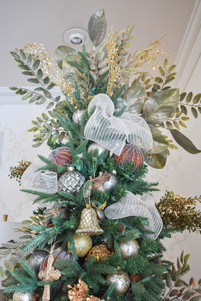 A Christmas Tree Topper in a Green and Gold Fresh Evergreen Christmas Home Tour