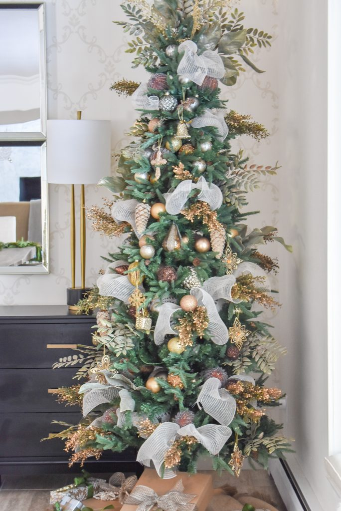 A Christmas Tree in a Green and Gold Fresh Evergreen Christmas Home Tour