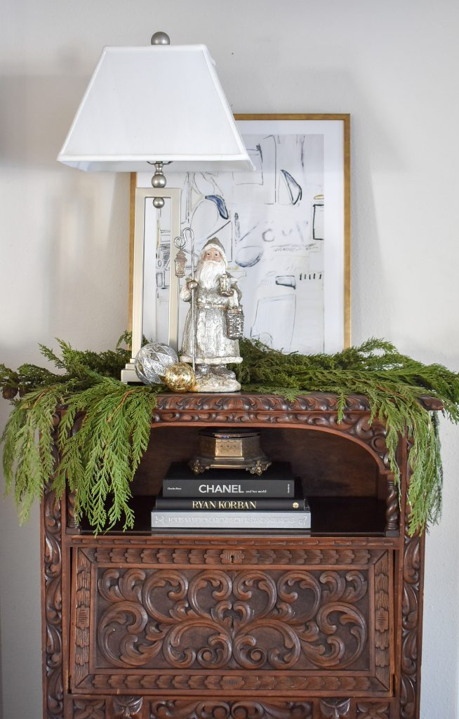 An antique chest decorated for Christmas with Fresh Evergreens