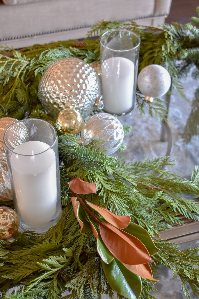 A close-up of a Silver and Gold Christmas Centerpiece with Evergreens