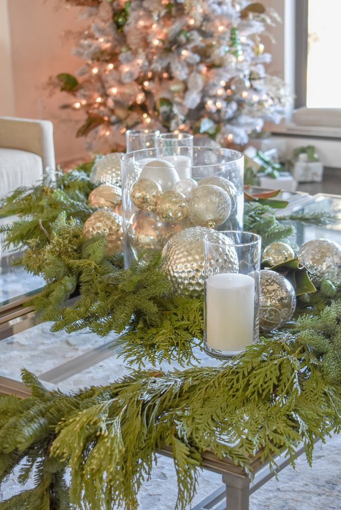 A beautiful Silver and Gold Christmas Centerpiece with Evergreens