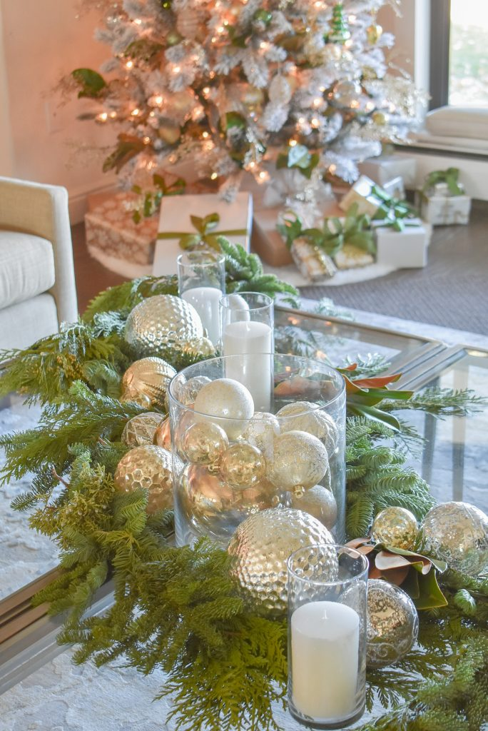 A Silver and Gold Christmas Centerpiece with Evergreens that matches a Christmas Tree