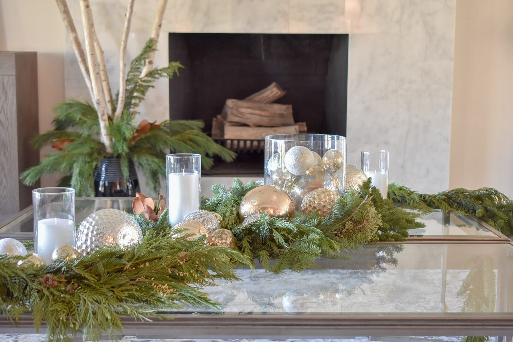 Silver and Gold Christmas Centerpiece with Evergreens on glass coffee tables