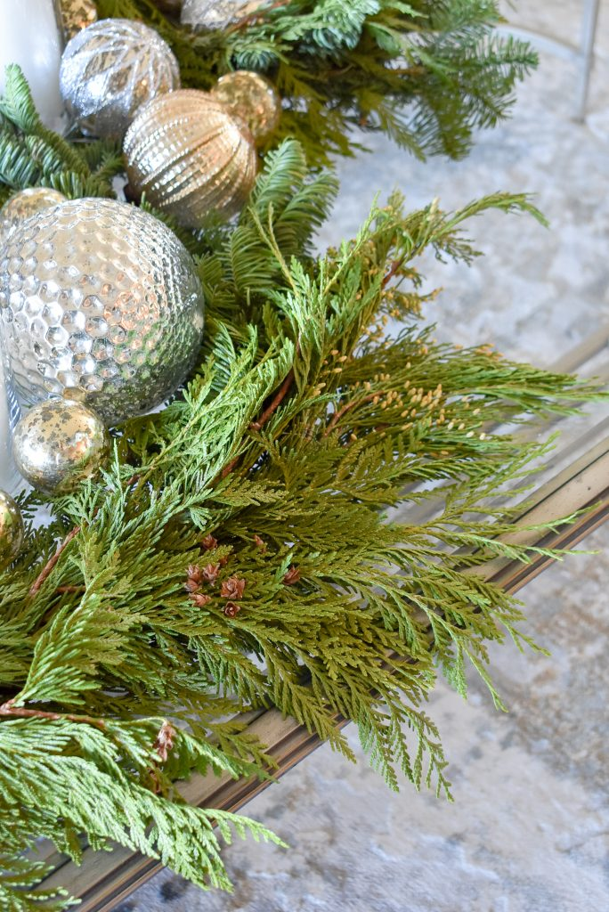 Evergreens on a Silver and Gold Christmas Centerpiece with Evergreens