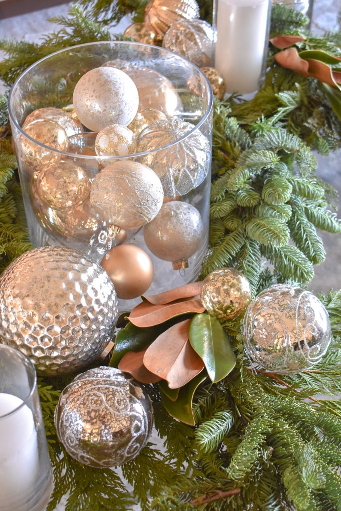 Christmas Ornaments on a Silver and Gold Christmas Centerpiece with Evergreens